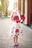 A little girl holds a boxes with gifts royalty free stock photo