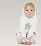Little girl in a white dress with a hood. Stock Photography