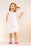 Little girl in white dress and pink shoes Royalty Free Stock Photos