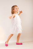 Little girl in white dress and pink shoes Royalty Free Stock Photography