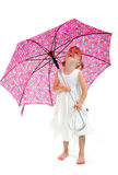 Little girl in white dress with pink umbrella. Looking up Royalty Free Stock Image