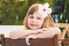 Little girl with white flower in hair Royalty Free Stock Photos