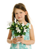 Little girl with white flowers. Portrait of beautiful smiling little girl with white flowers Royalty Free Stock Images
