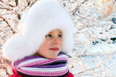 Little girl in a white fluffy hat Royalty Free Stock Photo