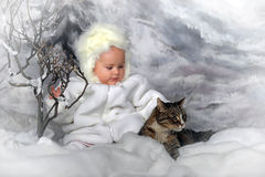 Little girl in a white fur coat and hat and cat Stock Images