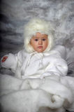 Little girl in a white fur coat and hat Stock Photos
