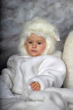 Little girl in a white fur coat and hat Royalty Free Stock Images