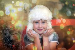 Little girl in a white fur hat Stock Image