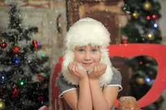 Little girl in a white fur hat Royalty Free Stock Photos