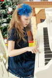 Little girl at a white Grand piano. Stock Photography
