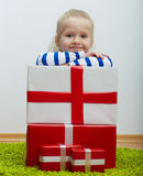 Little girl with white hair and many gifts Royalty Free Stock Photo