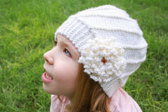 Little girl in white hat and pink sweater Royalty Free Stock Photo