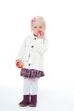 Little girl in a white knitted jacket Royalty Free Stock Images