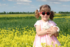 Little girl with white rabbit Stock Images