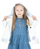 Little girl in a white raincoat over white Stock Image