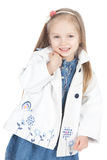 Little girl in a white raincoat over white Royalty Free Stock Images