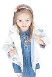 Little girl in a white raincoat over white Stock Photos