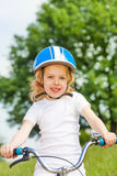 Little girl in a white shirt with bicycle Stock Image