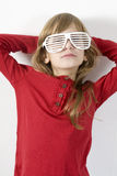 Little girl in white sun glasses Stock Photo