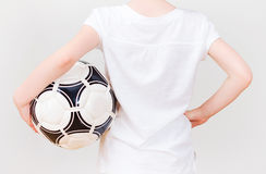 Little girl in white T-shirt with ball. Stock Images