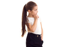 Little girl in white T-shirt and black skirt Royalty Free Stock Images