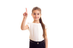 Little girl in white T-shirt and black skirt Stock Images
