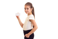Little girl in white T-shirt holding white card Royalty Free Stock Photography