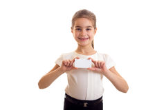 Little girl in white T-shirt holding white card Royalty Free Stock Photo