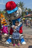 Little girl with white tiger mascot. Bangkok, Thailand - Jan 13, 2018 Unidentified little girl is happy with white tiger mascot at Safari World Zoo on holiday Stock Photos