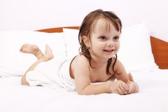Little girl in white towel Stock Photo