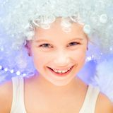 Little girl in a white wig Stock Image