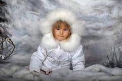 Little girl in white winter coat Stock Images