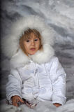 Little girl in white winter coat Royalty Free Stock Images