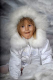 Little girl in white winter coat Royalty Free Stock Photo