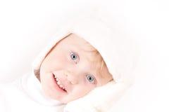 Little girl in white winter hat. Little girl in white winter fleece hat & mittens portrait on white Royalty Free Stock Photo