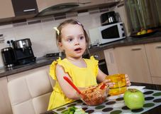 Little girl who eat healthy food Stock Photo