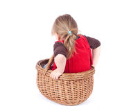 Little girl in wicker basket Royalty Free Stock Photos