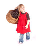 Little girl with wicker basket Royalty Free Stock Photography