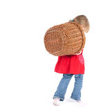 Little girl with wicker basket Stock Image