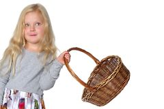 Little girl with a wicker basket. Made of willow twigs. The concept of harvesting, mushrooms and berries. Isolated over white background Royalty Free Stock Photo