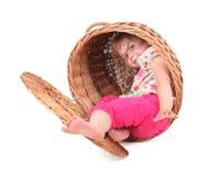 Little girl in wicker box Royalty Free Stock Photos