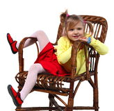 Little girl in a wicker chair Royalty Free Stock Photos