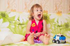 Little girl widely opened mouth Royalty Free Stock Images