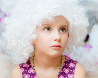 Little girl in a wigs Royalty Free Stock Images