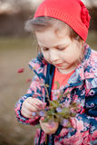 A little girl wihr a bouquet of flowers in her hands. Stock Images