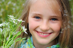 Little girl with the wild flowers Royalty Free Stock Photography