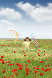 Little girl on wildflowers meadow Stock Image