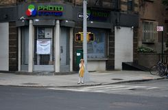 A little girl in Williamsburg, New York. New York, USA - 3 September 2016 - a little girl standing alone in the street in Williamsburg Royalty Free Stock Photography