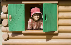 Little girl in window Stock Image