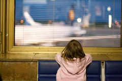 Little girl at the window in airport at night. Stock Photography